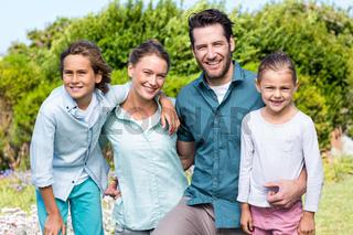 Happy family smiling at camera