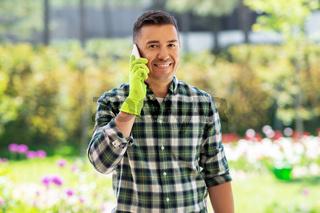 happy man calling on smartphone at summer garden