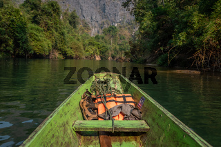Wooden boat with life vests at Konglor Cave, Thakhek, Laos