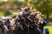 Person in event with feather costume on head