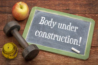 body under construction - fitness concept