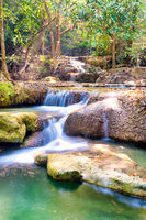 Cascades of tropical waterfall in wild jungle forest