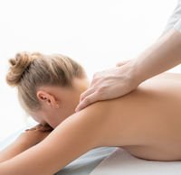 Woman on couch having massage in spa saloon