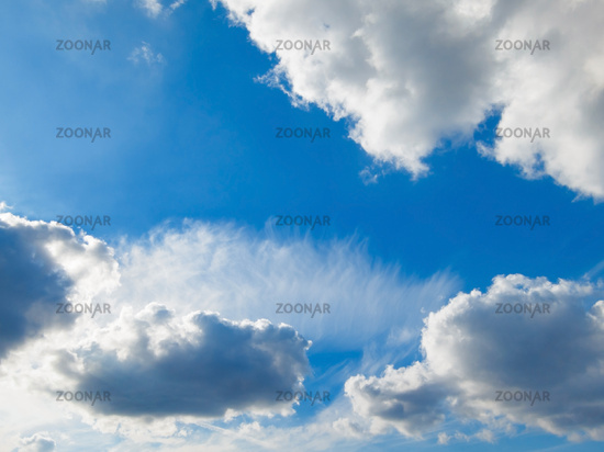 Blue sky and white fluffy clouds