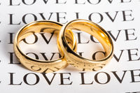 Golden wedding ring with a word love