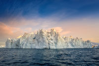 floating glaciers in the rays of the setting sun during a polar night