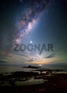 Milky way over the coast as dawn approaches