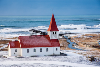 The Vik I Myrdal  church at the top of the hill offering picturesque images of the atlantic ocean and the village of vik in Iceland