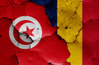 flags of Tunisia and Chad painted on cracked wall