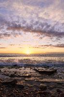 Sunrise on the rocky beach
