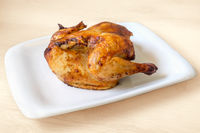 whole roasted chicken isolated on white background