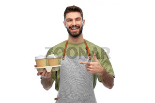 happy smiling barman in apron with takeaway coffee