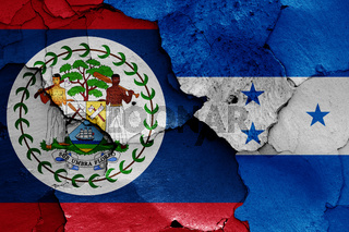 flags of Belize and Honduras painted on cracked wall