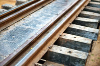 Old rail track with wooden sleepers and rusty rails
