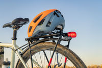 biking helmet on racks of a touring bike