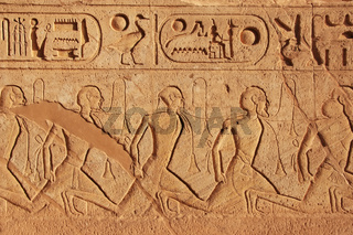 Ancient hieroglyphics on the wall of Great temple of Abu Simbel, Nubia