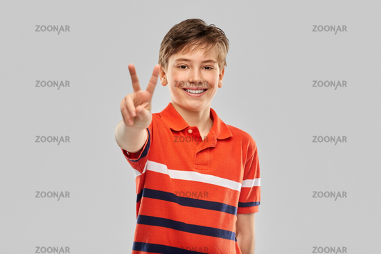 portrait of happy smiling boy in red polo t-shirt
