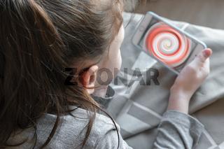 Little girl watching a smartphone