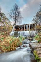 dam with a waterfall on the river