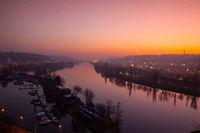 Small dock, boats and Vltava River in Prague, Czech Republic