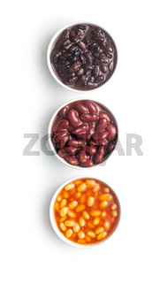 Various beans with sauce in bowls.