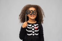 girl in black halloween dress with skeleton bones