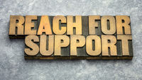 reach for support word abstract in wood type