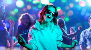 woman in hoodie and sunglasses at nightclub