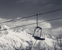 Ski lift in snow winter mountains at nice sunny day