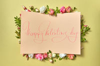 Paper Valentine's card with flowers frame.