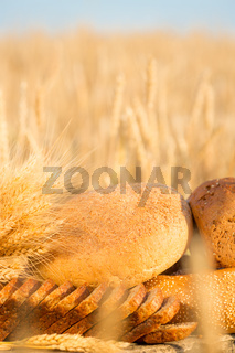 Bread and wheat on the wooden table