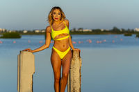 A Lovely Latin Model Poses With The Rising Sun On A Romantic Caribbean Beach
