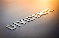 Word dividende written with white solid letters