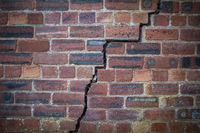 Cracked Red Brick Wall