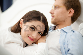 Woman resting on her husbands chest. Calm gentle woman resting on mans chest. Sweet beautiful lady having rest on her husbands chest with his face blurred in background
