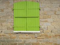 Green closed wood shutters