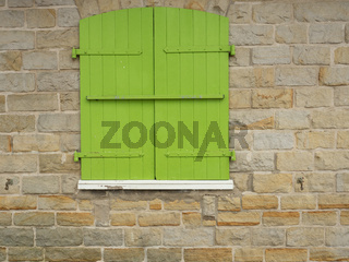 Green closed wood shutters
