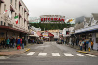 Ketchikan, Alaska/USA – August 5, 2015: A view of Main Street businesses and tourists exploring downtown Ketchikan August 5, 2015.