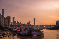 Ships moored in Chongqing town dock at dusk