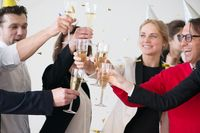 Business people drink champagne