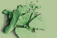 Green eye shadow powder as makeup palette closeup, crushed cosmetics and beauty texture