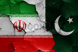 flags of Iran and Pakistan painted on cracked wall