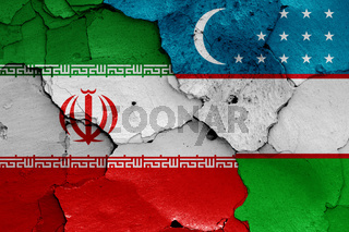 flags of Iran and Uzbekistan painted on cracked wall