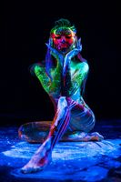 Girl with ultraviolet color pattern bodyart shot