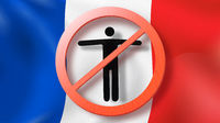 Warning sign with crossed out man on a background French flag.