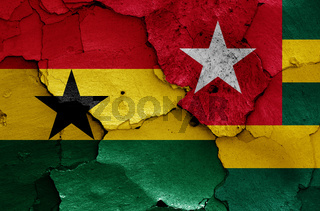flags of Ghana and Togo painted on cracked wall