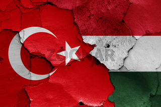 flags of Turkey and Hungary painted on cracked wall