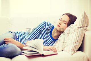 smiling teenage girl sleeping on sofa at home