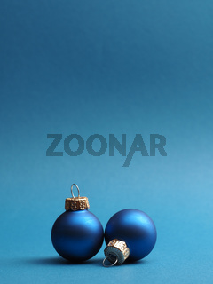 Blue vintage Christmas baubles on a blue background