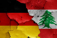 flags of Germany and Lebanon painted on cracked wall